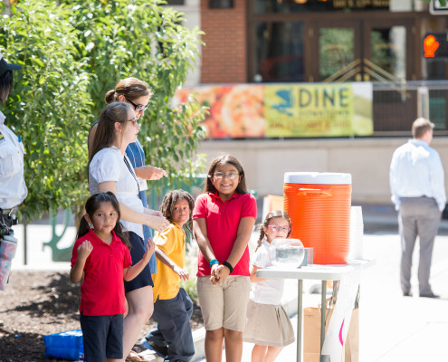 Crossroads Academy students and teachers will be selling lemonades at six Downtown street corners over lunch on Wednesday.
