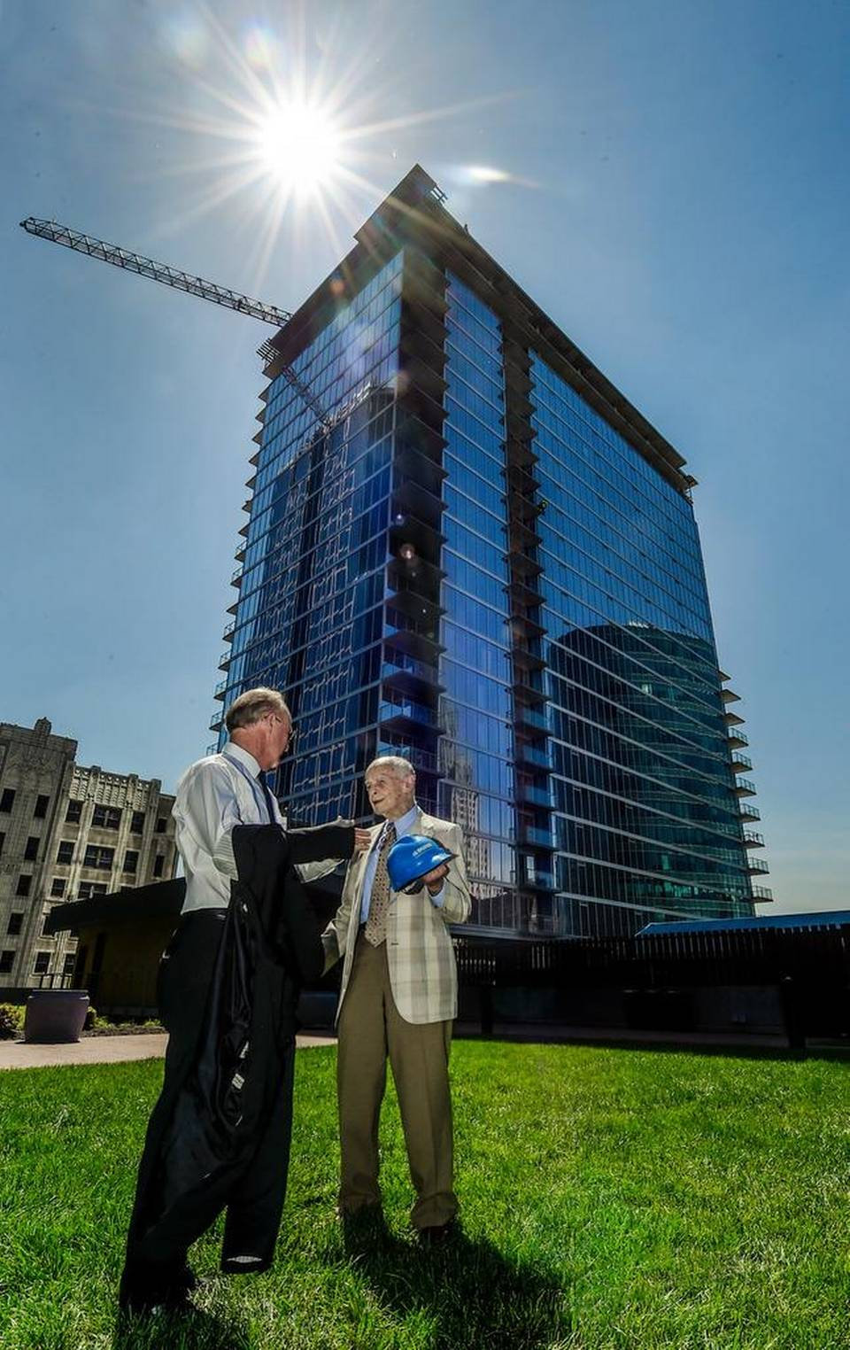 "Mark Humphreys (left), Humphreys and Partners Architects, talked with Bill Dunn Sr. of J.E. Dunn Construction on Wednesday during the ""topping out"" ceremony at the One Light apartment tower at 13th and Walnut streets."