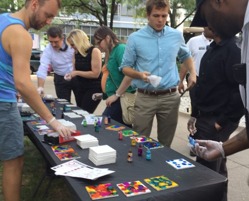 The DTC Ambassadors getting involved  with The Arts Asylum: Community Tile. Photo by Ann Holliday.